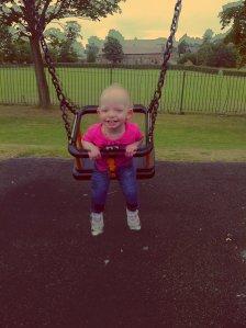 Chloe on the swings